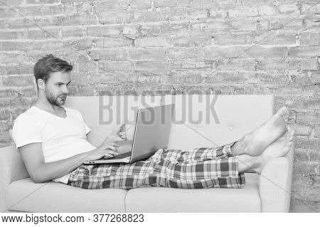 Online Education. Handsome Man Communicate On Laptop. Use Notebook Before Sleep. Male Blogger Use In