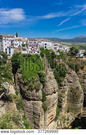 White Houses And Surrounding Landscape Of Historic City Ronda, Spain