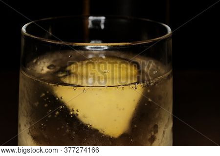 Glass Of Beer With Fresh Lemon Inside