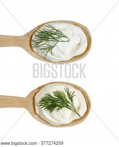 Wooden Spoon With Sour Cream Isolated On A White Background