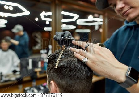 Trendy Haircut. Close Up Shot Of Professional Male Barber Working With Scissors And Hair Comb, Makin