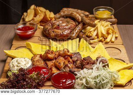 Grill Set On A Wooden Board Grilled Chicken, Pork Skewers, Pork Ribs, Grilled Sausages, Vegetables,