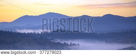 Panorama Morning Fog In The Mountains. Dawn In The Mountains. The Morning Sun In The Fog. Colorful D