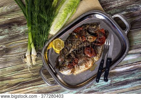 Seafood. Two, Big, Baked Gilt-head Bream (sparus Aurata) With Vegetables On A Plate Close-up, On A W