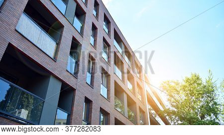 Contemporary Residential Building Exterior In The Daylight. Modern And New Apartment Building. Multi