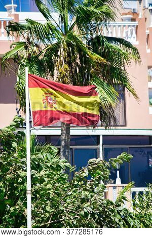 A Floating Spain Flag Captured In Malaga Located In Costa Del Sol Occidental Is A Comarca In Andalus