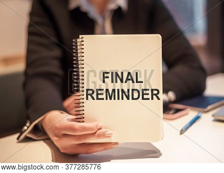 Business Woman Holding A Notebook With The Text Final Reminder. Concept Meaning Written Or Spoken Me