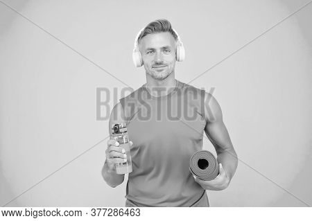 Hydration For Athletes. Fit Athlete Gold Water Bottle Blue Background. Drinking Water Before And Aft