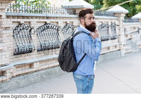 Vacation Concept. Backpack For Urban Traveling. Hipster Backpack Urban Street Background. Bearded Ma