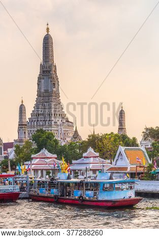 Boats On Chao Phraya River And Wat Arun, The Temple Of Dawn, An Important Buddhist Temple And A Famo