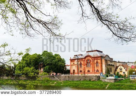 Transcarpathian Regional Philharmonic Society In The City Of Uzhgorod. The Building Is Red In A Roma