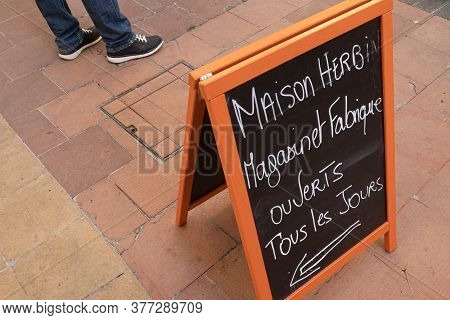 Menton, France - July 2, 2020: Advertising Board Of The Confiturerie Herbin In Menton That Has An En