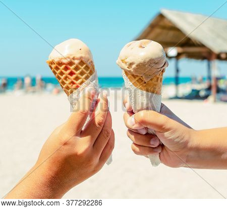 Couple Kids Hands Holding Ice Cream Cones At The Beach Background In Summer Vacation. Summer Food, S