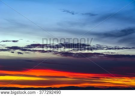 Natural Sunset. Bright Dramatic Sky And Dark Ground. Landscape Under Scenic Colorful Sky. Sun Over S