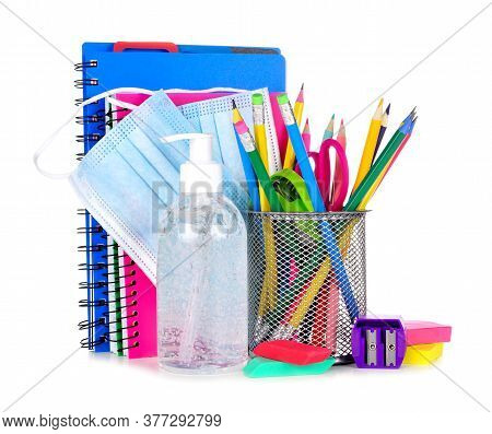 Group Of School Supplies And Covid 19 Prevention Items Isolated On A White Background. Back To Schoo