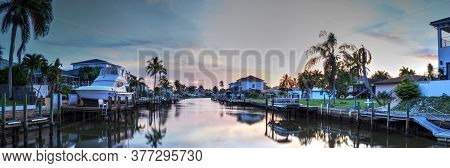 Waterway Leading To The Ocean Near Vanderbilt Beach In Naples, Florida At Sunset.