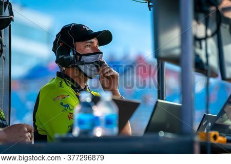 July 18, 2020 - Newton, Iowa, USA: IndyCar Team Manager, Larry Foyt Jr watches as his teams prepare to race for the Iowa INDYCAR 250s at Iowa Speedway in Newton, Iowa.