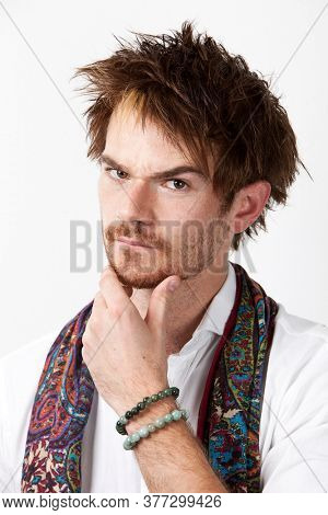 Close-up of young contemplating man against white background