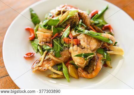 Thai Food Stir Fried Fish With Pepper Chili And Herb On White Plate / Tilapia Fish Cooked Food