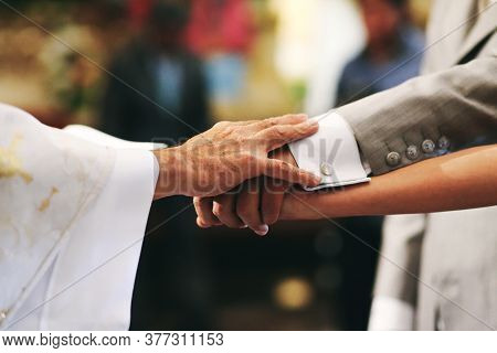 Getting Married, Hands From Bride, Groom And Priest In A Mexican Church In Mexico City