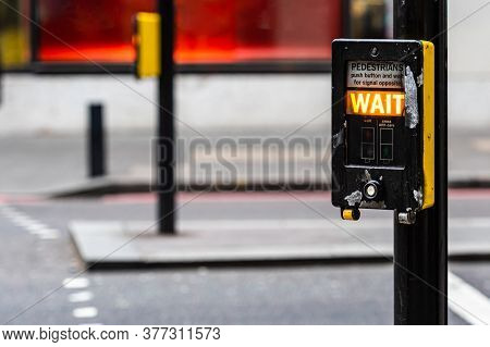 Crosswalk Button For Pedestrian With Light Warning On A Defocused Background , London, Uk - Image
