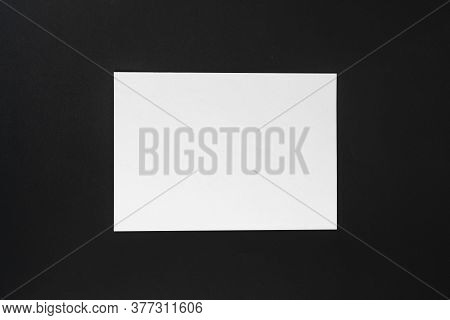 A Blank Empty White Paper Sheet Of A4 Format On The Table In Office, Mockup Copy Space