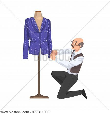 Male Tailor Adjusting Jacket On Mannequin, Clothing Designer Tailor Working At Atelier Creating Outf