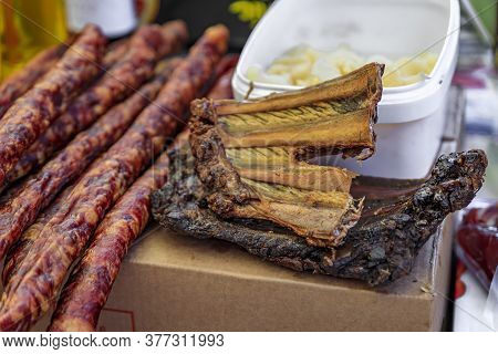 Selection Of Pork Sausages And Cured And Smoked Pork Ribs On Display At A Street Market In Old Town
