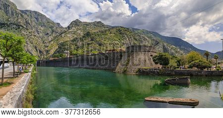 Kotor, Montenegro - June 01, 2019: Panorama Of Kotor Bay, Mountains And The Ancient Stone City Wall