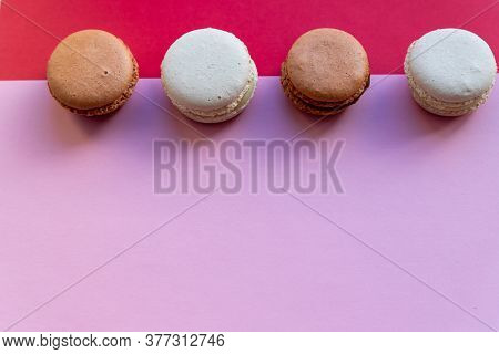 Colorful Cake Macaron Or Macaroon, White Meringues On Red, Pink Background. French Almond Cookies On