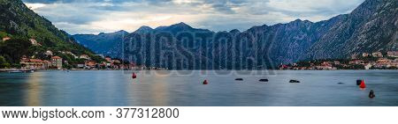 Panoramic View Of Kotor Bay Or Boka Kotorska With Mountains, Crystal Clear Water At Sunset In The Ba
