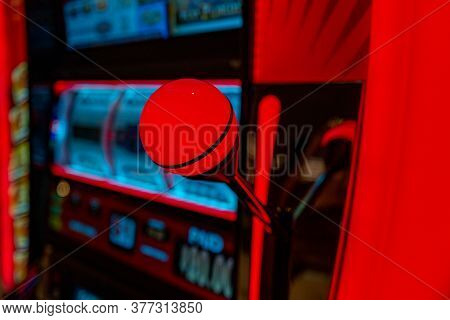 Casino Slot Machines. Digital Slot Machine Closeup. City Gabling Concept. Good Luck, Money, Red Hand