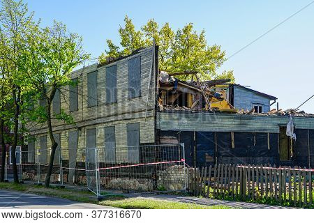 An Old Abandoned Two-storey Wooden House In The City Under Demolition Stage
