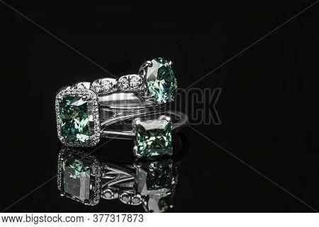 Emerald Green Diamond Engagement Rings On Dark Background