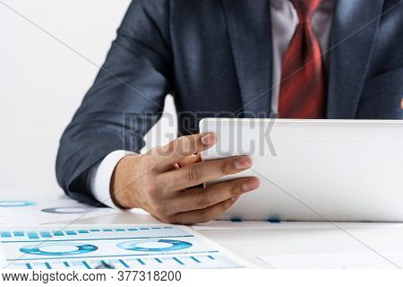Businessman Using Tablet Computer At Office Desk. Financial Expertise And Consulting. Manager In Sui