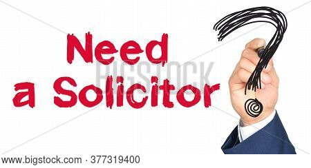 Hand With Marker Writing: Need A Solicitor. Hand Of A Businessman With A Marker.