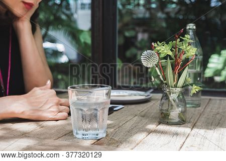 Healthy Nutrition Woman Having Fresh Glass Of Water In Restaurant.