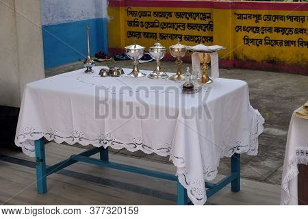 KUMROKHALI, INDIA - FEBRUARY 23, 2020: Chalices arranged beside the altar before the mass in the church in the village of Kumrokhali, West Bengal, India