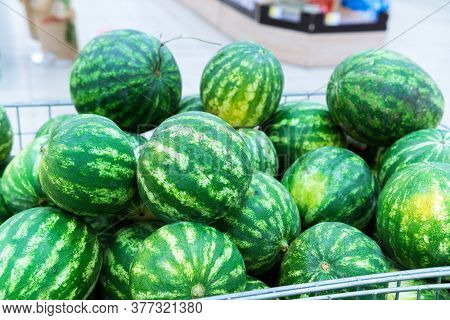 Ripe Watermelons On The Shelves Of A Hypermarket