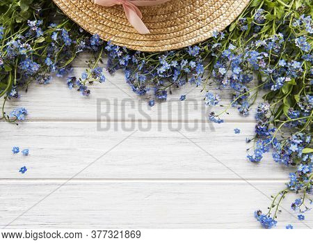 Summer Background, A Bouquet Of Forget-me-nots And A Straw Hat, Flat Lay