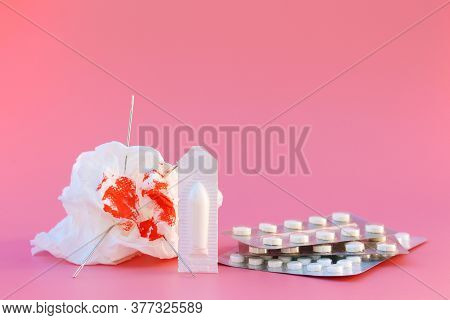 Toilet Paper With Blood, Pills, Candle. Concept Of Hemorrhoid Treatment.