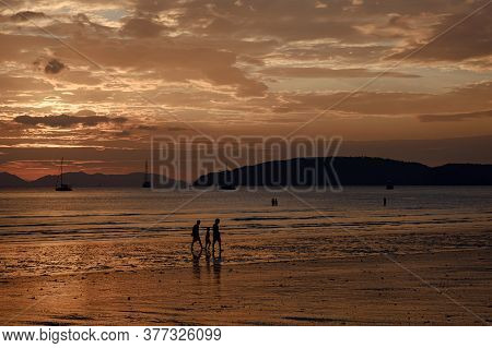 People Walking At The Beach On Beautiful Summer Sunset