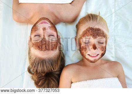 Beautiful Girls With Facial Mask Coffee Scrub. Top View.