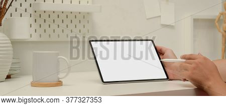Male Worker Pointing On Mock Up Tablet With Stylus Pen While Sitting At Worktable In Home Office