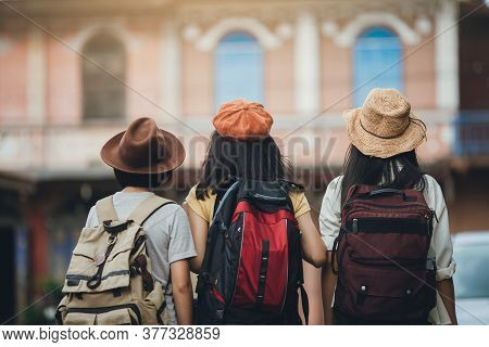 Behind View Of Woman Group Backpacker Travel On Street Together, Friendship Traveller Backpack Trave