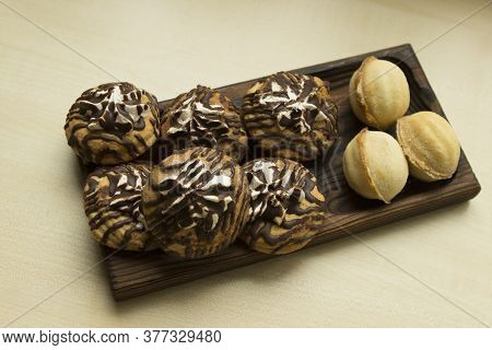 Two Kinds Of Dessert Treats Cookies On A Rectangular Wooden Tray Plate. Shortbread Decorated With Ma