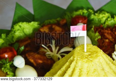Indonesian Flag On Nasi Tumpeng, Traditional Indonesian Cuisine, Independence Day Concept.