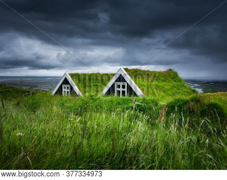 Old Historic Houses On The Field In Iceland. Natural Icelandic Background. Travelling On Iceland. Fa