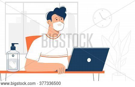 Male Office Worker Looking At His Laptop, Wearing Face Mask And Having Hand Sanitizer At Workplace.