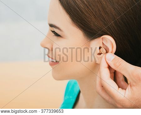 Young Patient With Intra-ear Hearing Aid, Close-up On Female Ear. The Hearing Solution, Audiologist